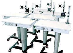 Height-adjustable tables in serial production.